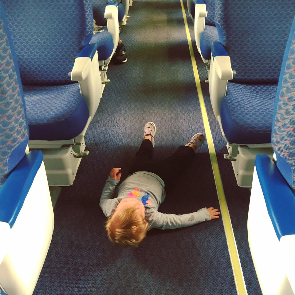 Kid Laying on the Train Floor