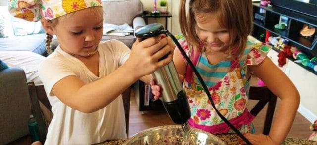 Two kids cooking during sleepover