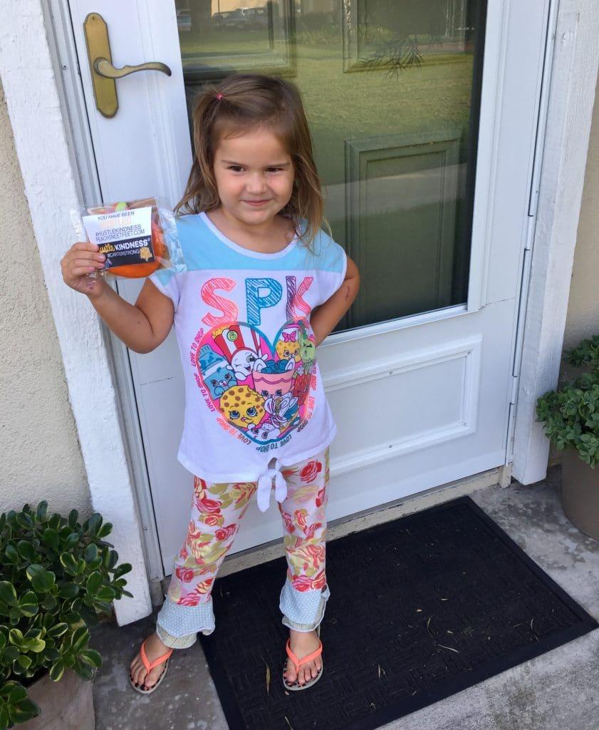 Kid giving away cookies