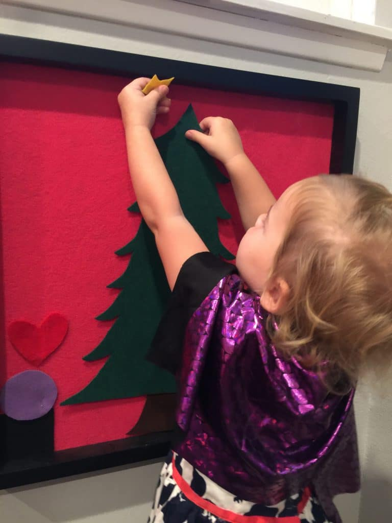 2 Year old Decorating for Christmas